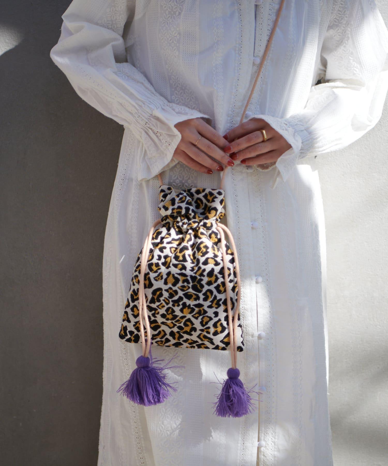 Discoat(ディスコート) タッセル付ジャガード巾着トートバッグ