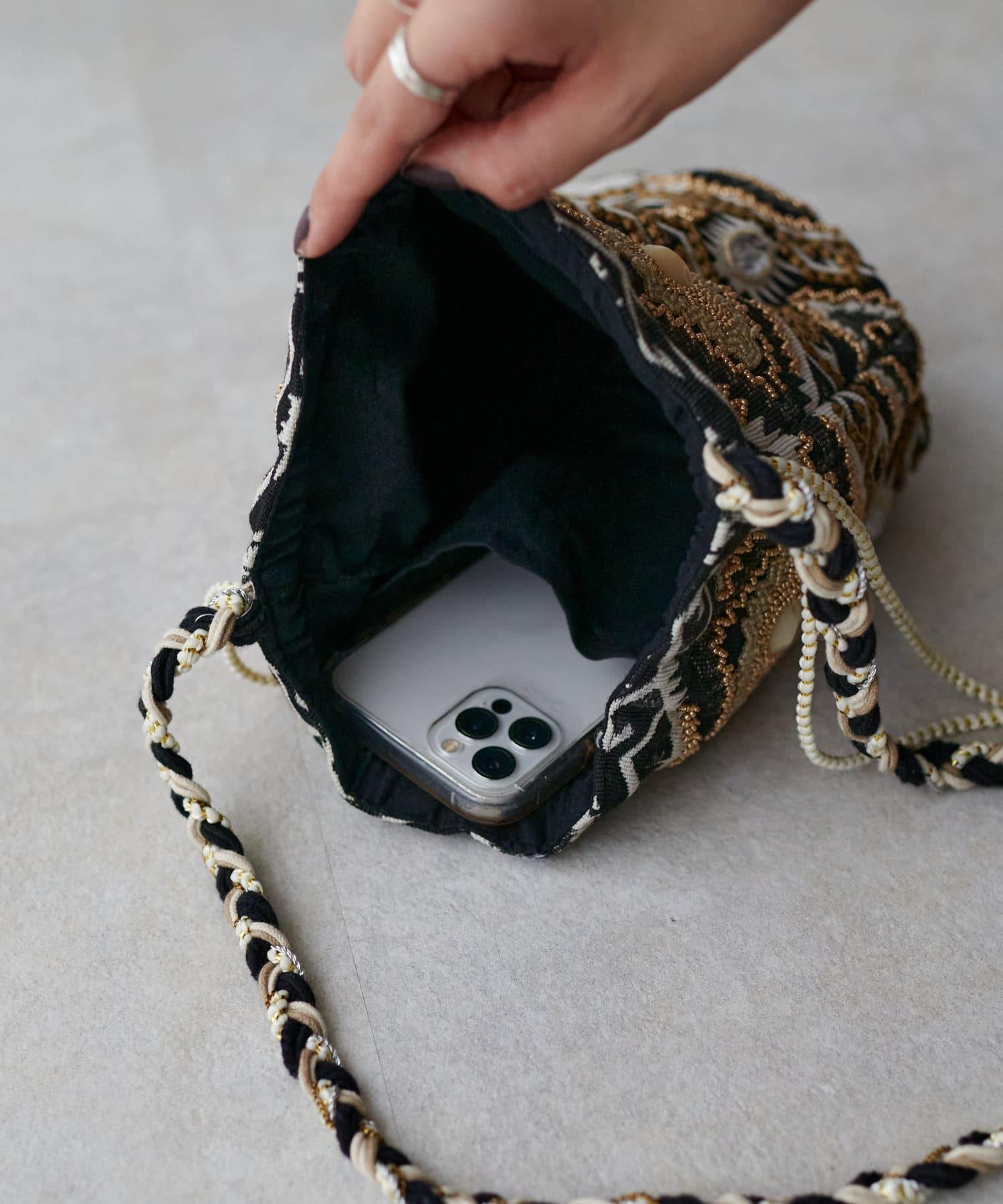 Discoat(ディスコート) ジャガードビーズ使い巾着ショルダーバッグ